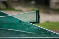 A wet table tennis plate after the rain