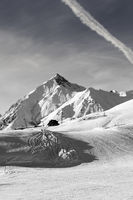 Black and white view on snowy ski slope