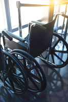 Wheelchairs for the disabled. Vertical shot