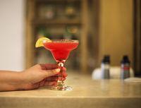 Strawberry margarita on bar counter