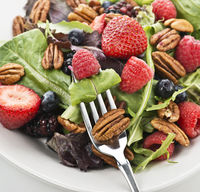 Fresh salad leaves with berries and peanuts