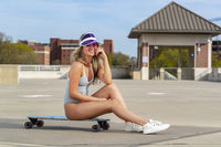 Gorgeous Young Coed Model Enjoying The Warm Weather With Her Skateboard