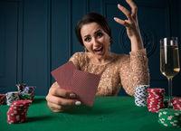 Beautiful woman playing in casino