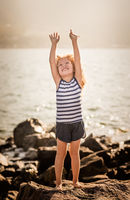 Little girl with raised hands