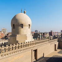Fence of Ibn Tulun Mosque revealing dome of Amir Sarghatmish mosque, Cairo, Egypt