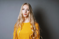 cool young woman with long blond hair