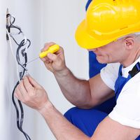 Electrician stripping electrical wires