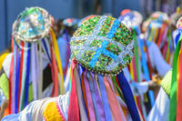 Men dressed in colorful clothes in a popular religious festival