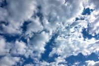 Clear blue sky with plain white cloud with space