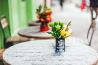 Flowers stand on a snowy table