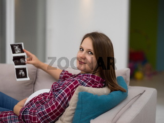 pregnant woman looking baby's ultrasound