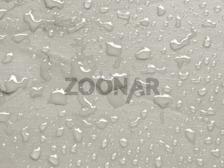 water drops on Tofu colored metallic surface