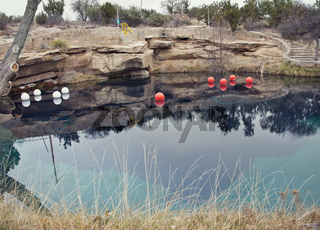 SANTA ROSA, NM, USA - March 11 ,2019. At 80 feet deep with clear blue water, the Blue Hole on Route 66 in Santa Rosa, NM.