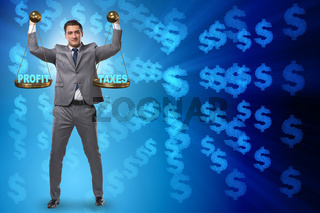Businessman comparing profit and taxes