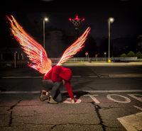 Fallen male angel with fire wings