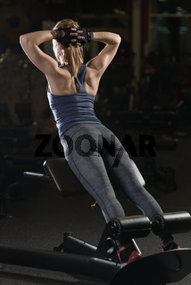 Woman doing strength exercises for abs muscles