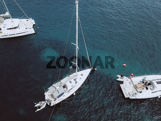 Aerial birds eye view video from drone of docked yacht