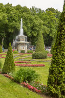 View of famous landmark of Peterhof Palace and its gardens close to city of St. Petersburg in Russia during sunny summer day