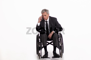 Disabled man in wheelchair in suit.