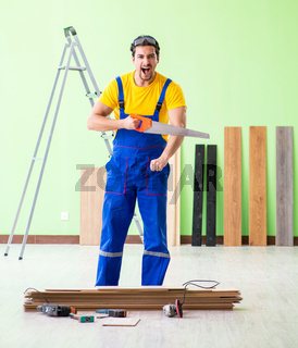 Professional contractor laying flooring at home