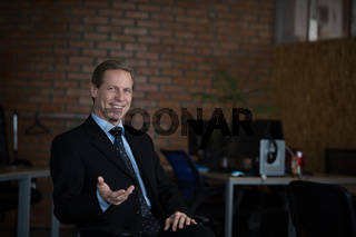 Confident businessman in office