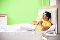Young man with virtual glasses in the bedroom