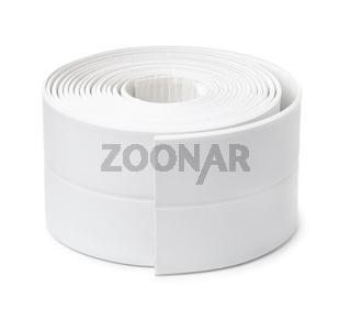 Roll of white adhesive flexible caulk strip