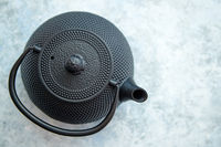 Black metal oriental teapot isolated