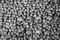 Human skulls and bones. Gothic vault. mass grave. Texture.
