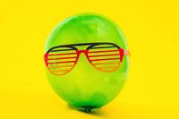 Green ballon with fun eyewear