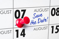 Wall calendar with a red pin - August 07