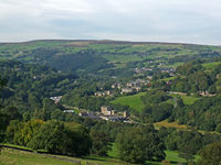 a panoramic view of west yorkshire countryside with trees and fields in the calder valley with the villages of luddenden and luddenden foot alongside the rochdale canal