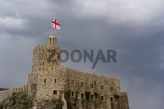 Rabati Castle flying the Georgian flag built on top of a cliff edge is a fortress castle in Akhaltsikhe