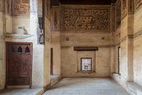 Stone wall with wooden window (Mashrabiya) at ottoman historic Beit El Set Waseela building (Waseela Hanem House), Cairo, Egypt