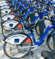bike rental station with many blue and white bikes in the city of Rennes in Brittany in France