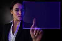 Business woman touching virtual display
