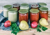 Home canning: pear puree, and tomato juice.