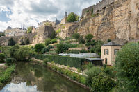 Alzette river Luxembourg city downtown Grund with fortifications and gardens