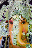 Close up view of an idol of Lord Ganesha, Tulshibaug Mandal, Pune, Maharashtra, India.
