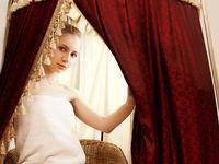 Spa. Pretty woman takes foot bath in parlour