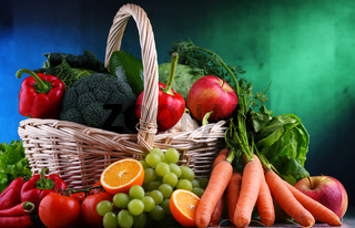 Fresh organic fruits and vegetables in wicker basket.