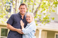 Happy Caucasian Couple in Front of House