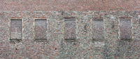 Brick wall with windows bricked over