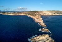 Es Ribell rocky coastline and tranquil Mediterranean Sea. Majorca, Spain