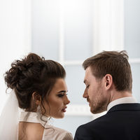 Groom and bride looking each to other