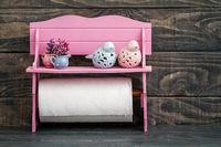 Pink Napkin Holder on Blue Wooden Background