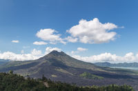 Mount Agung volcano against a blue sky