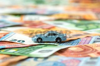 Car model on money background