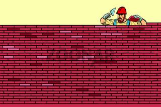 The Builder lays brick masonry at the top