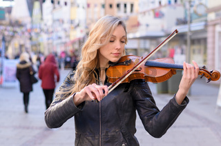 Woman playing violin in the street